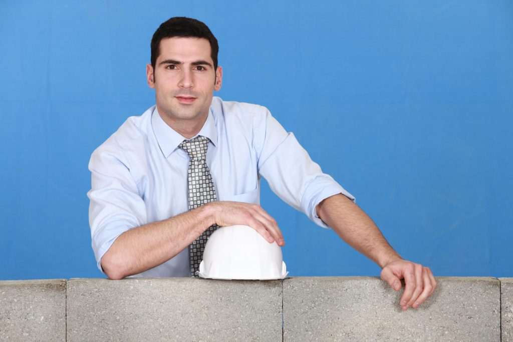 man in blue polo with white hard hat