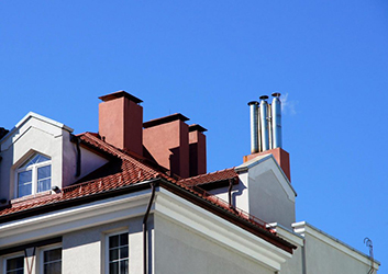smoking chimney above the house
