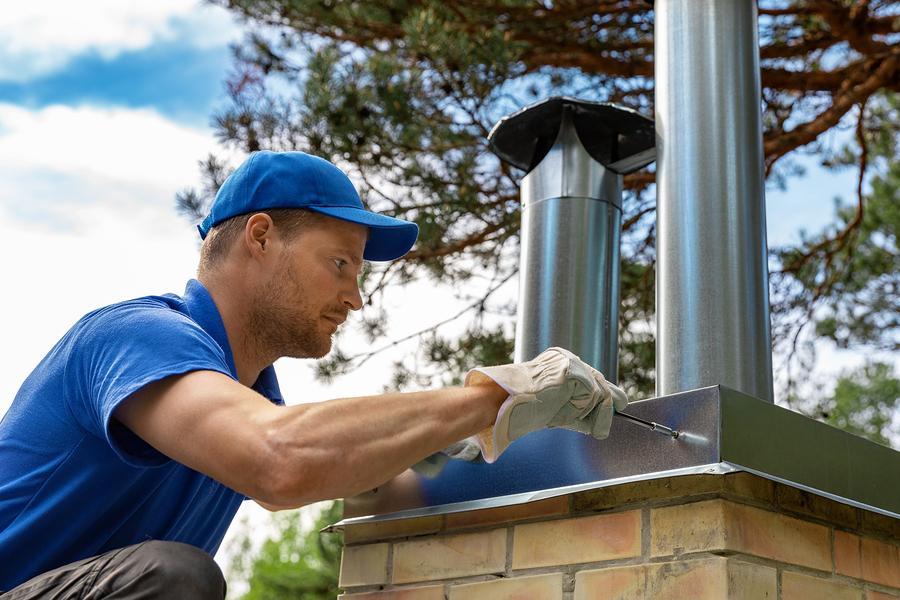 man installing the chimney